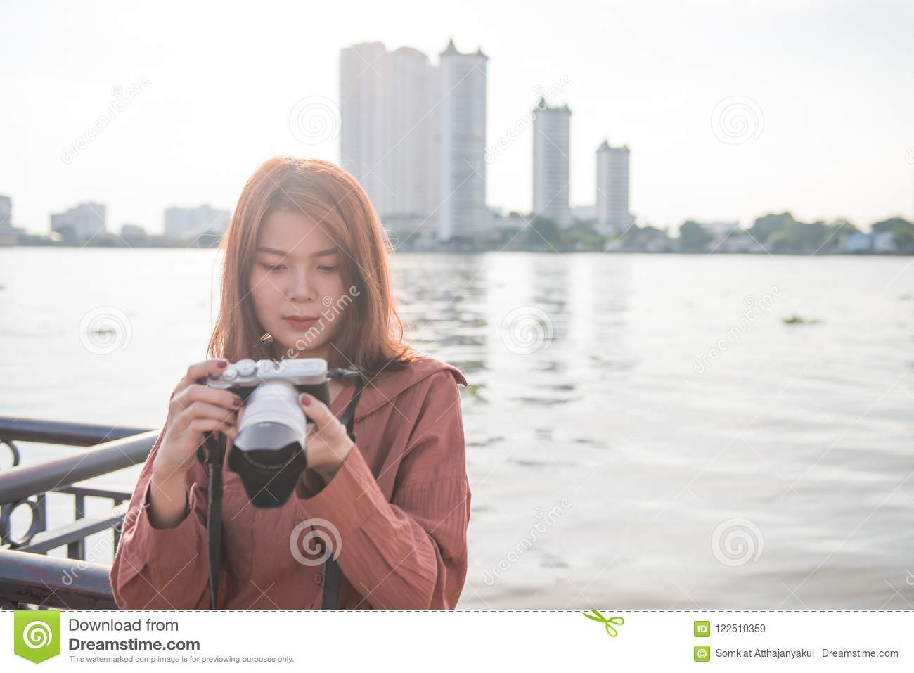 Attractive young asian girl enjoying her travel. travel concept
