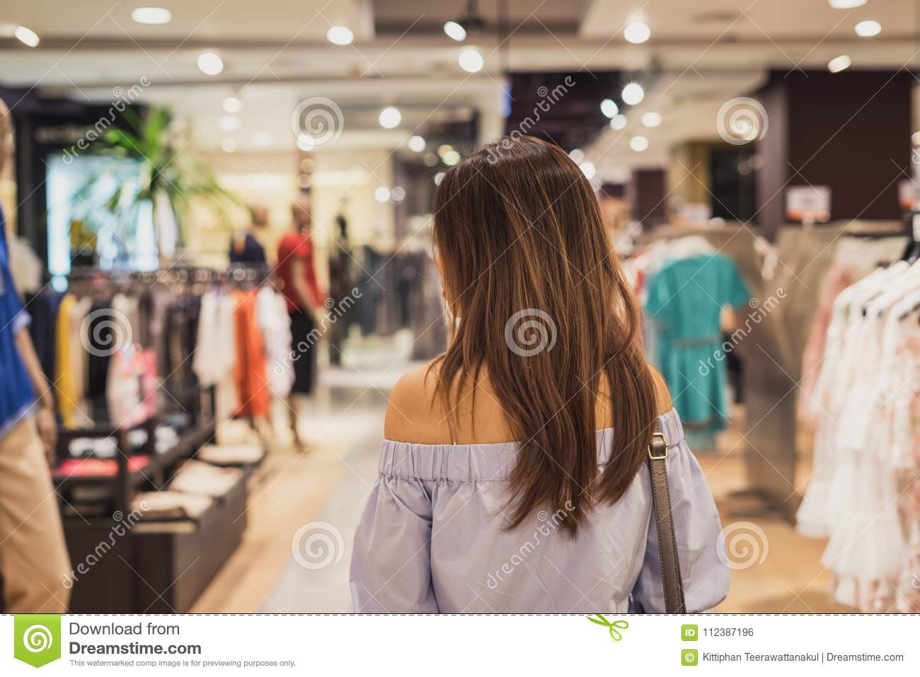 a43ca7fd44e Young Asian Woman Walking In Clothes Store Stock Photo - Image of ...