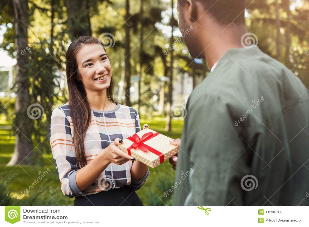 Man surprising his girlfriend with gift