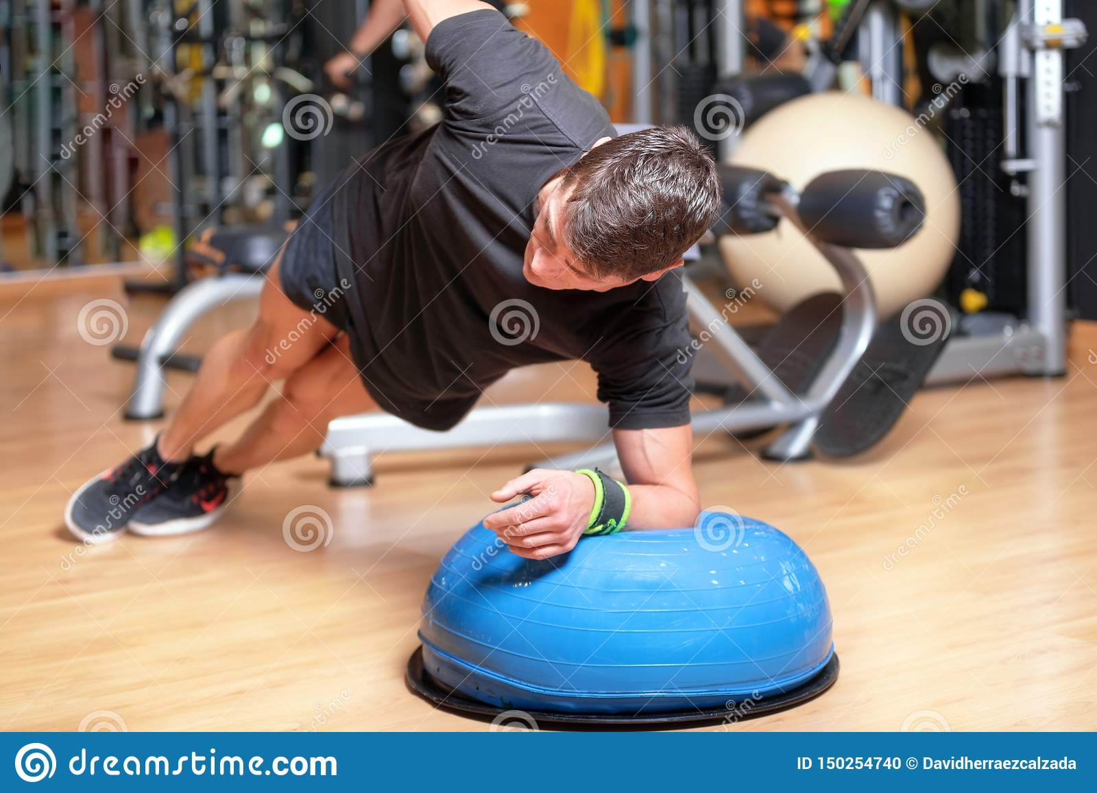 Young Man Doing Abdominal Exercises Workout Stock Image
