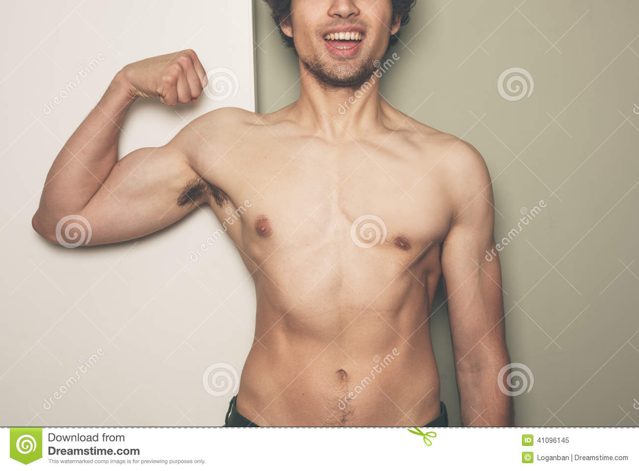 Young Athletic Man Flexing His Muscles Stock Photo - Image: 41096145