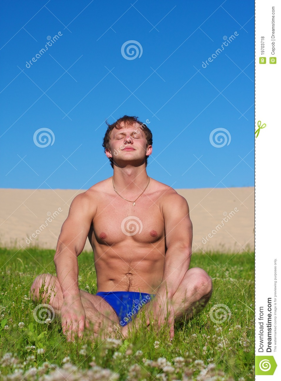 Young Man Shirtless Outdoors Hiking With Backpack On