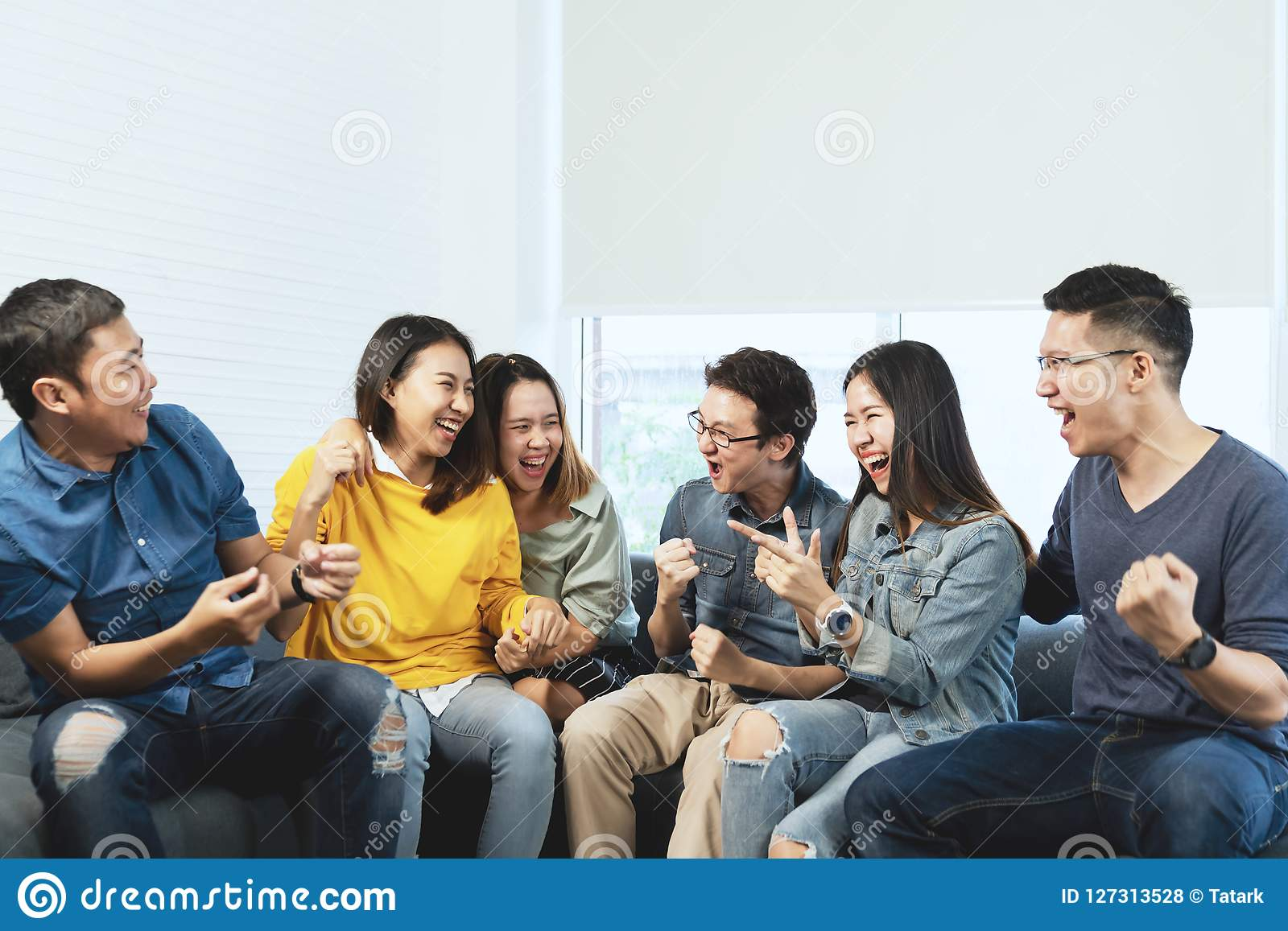 Young Attractive asian group of friends talking and laughing with happy in gathering meeting sitting at home