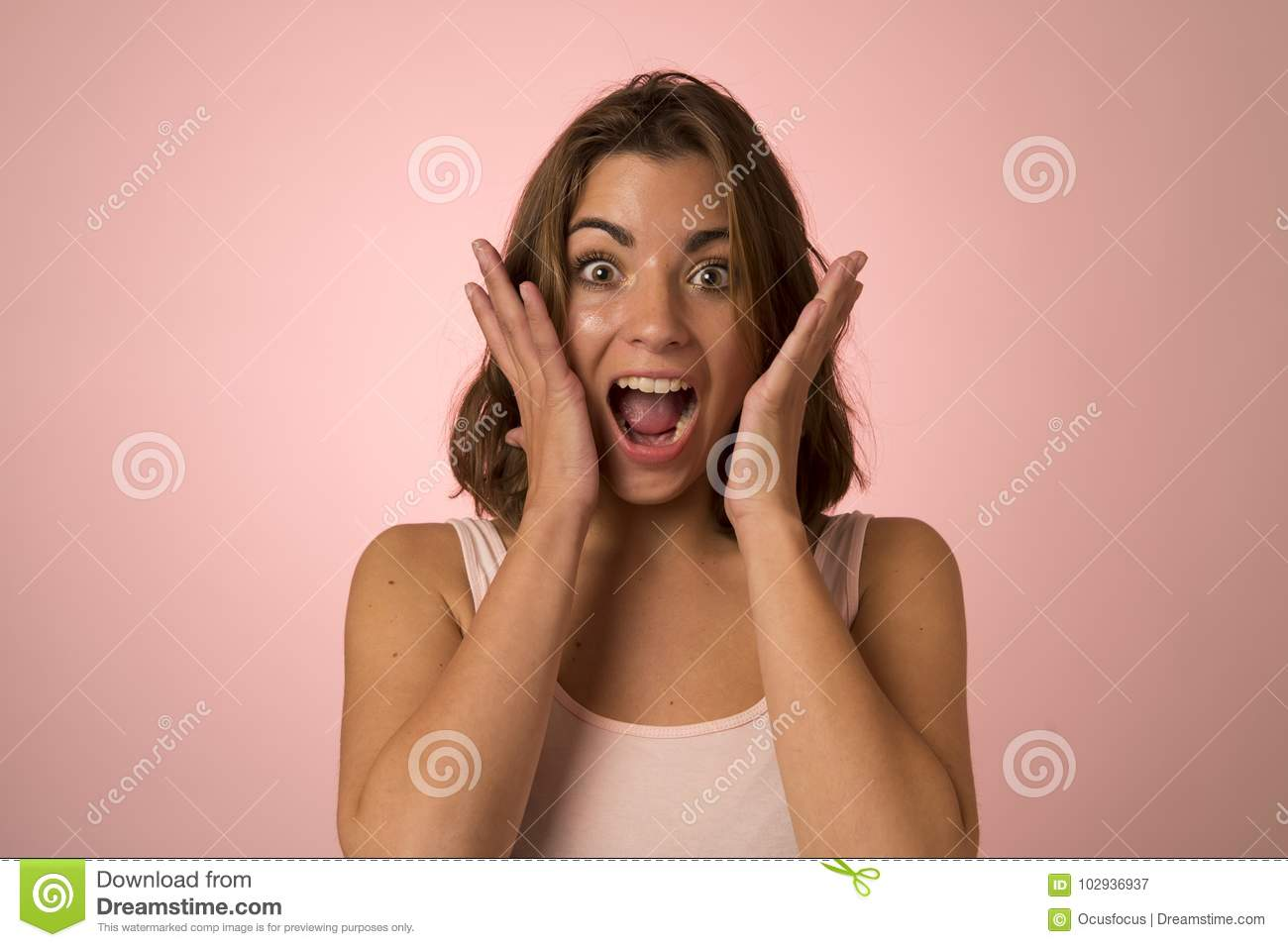 Young attractive and beautiful woman smiling excited and happy in nice shock and surprise showing positive face