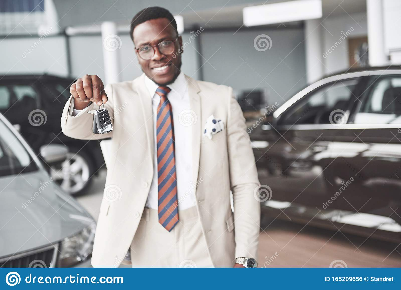 The Young Attractive Black Businessman Buys A New Car He Holds The Keys In His Hand Dreams Come True Stock Photo Image Of Convertible Excited 165209656