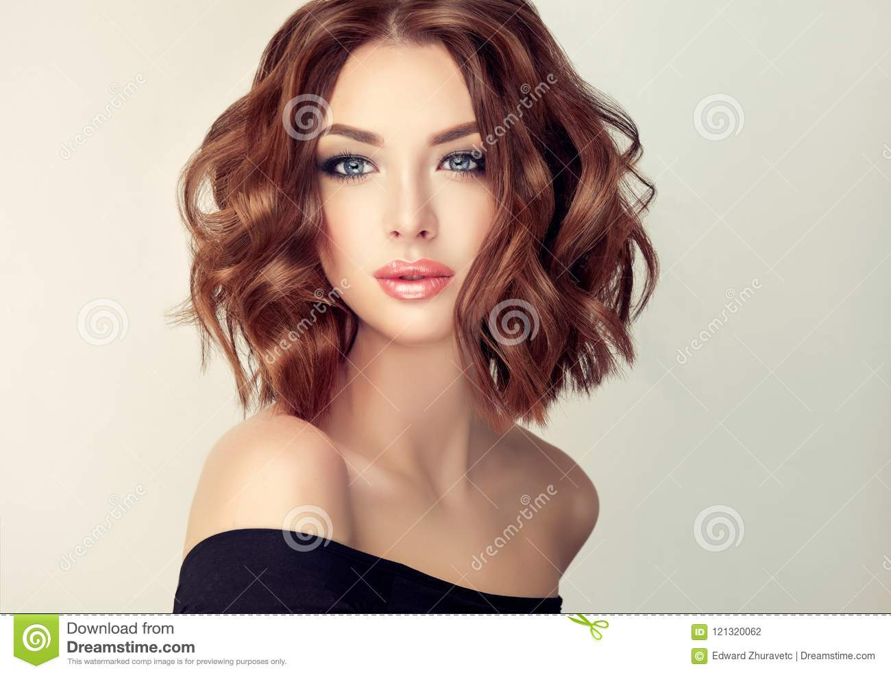 Young and attractive brown haired woman with modern, trendy and elegant hairstyle.