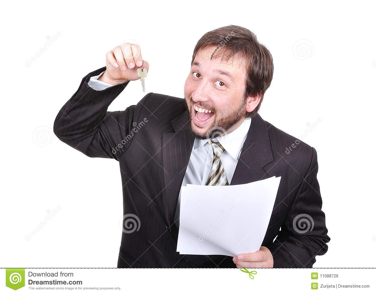 Young attractive businessman with keys and paper o