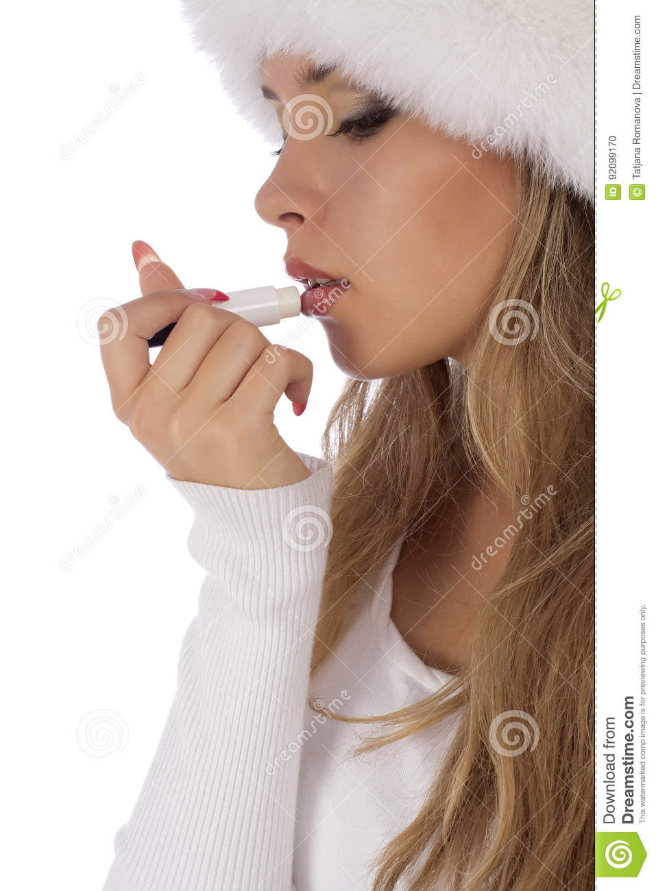 Young attractive girl applauding balsam for lips
