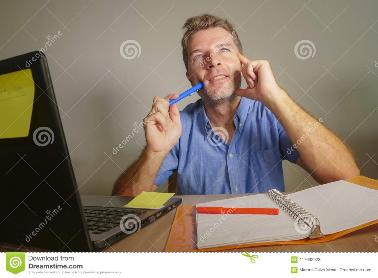Young attractive and happy business man looking thoughtful and pensive and if daydreaming thinking of successful project visualizi