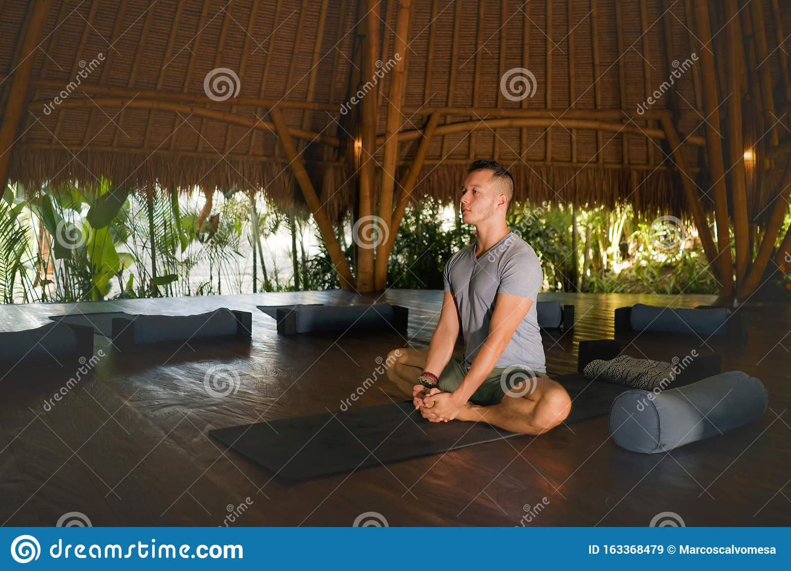 Relaxed Man Sitting In Yoga Pose Stock Photo - Image of