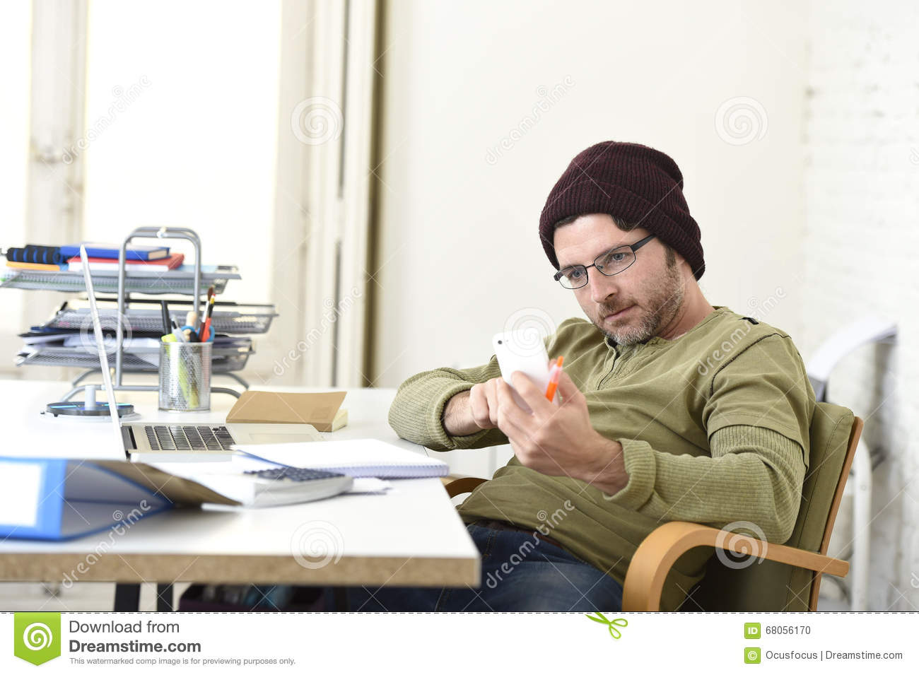 Working In Home Office young attractive hipster businessman working from home office with