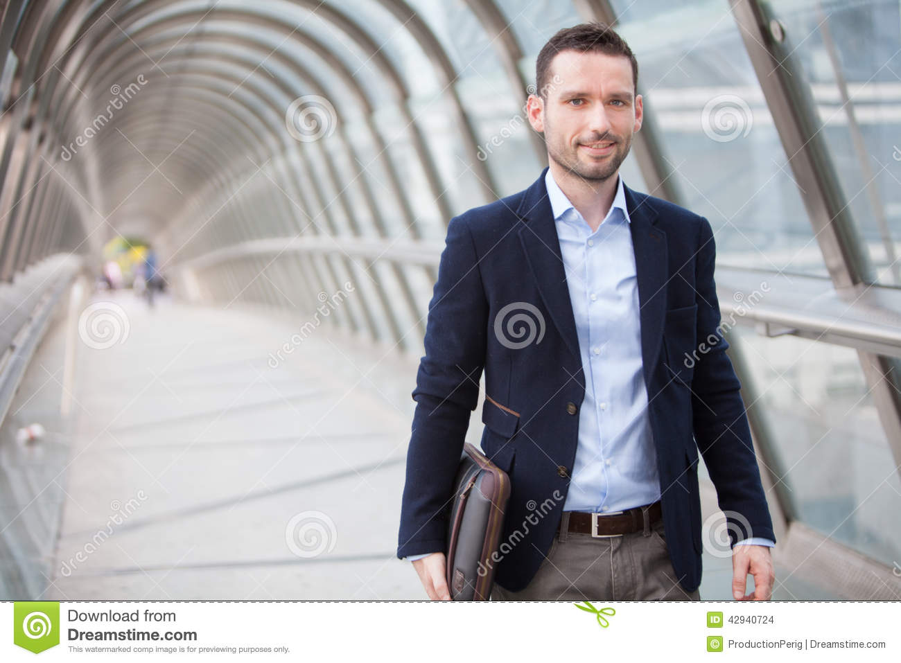 Young attractive man walking in a airport hall