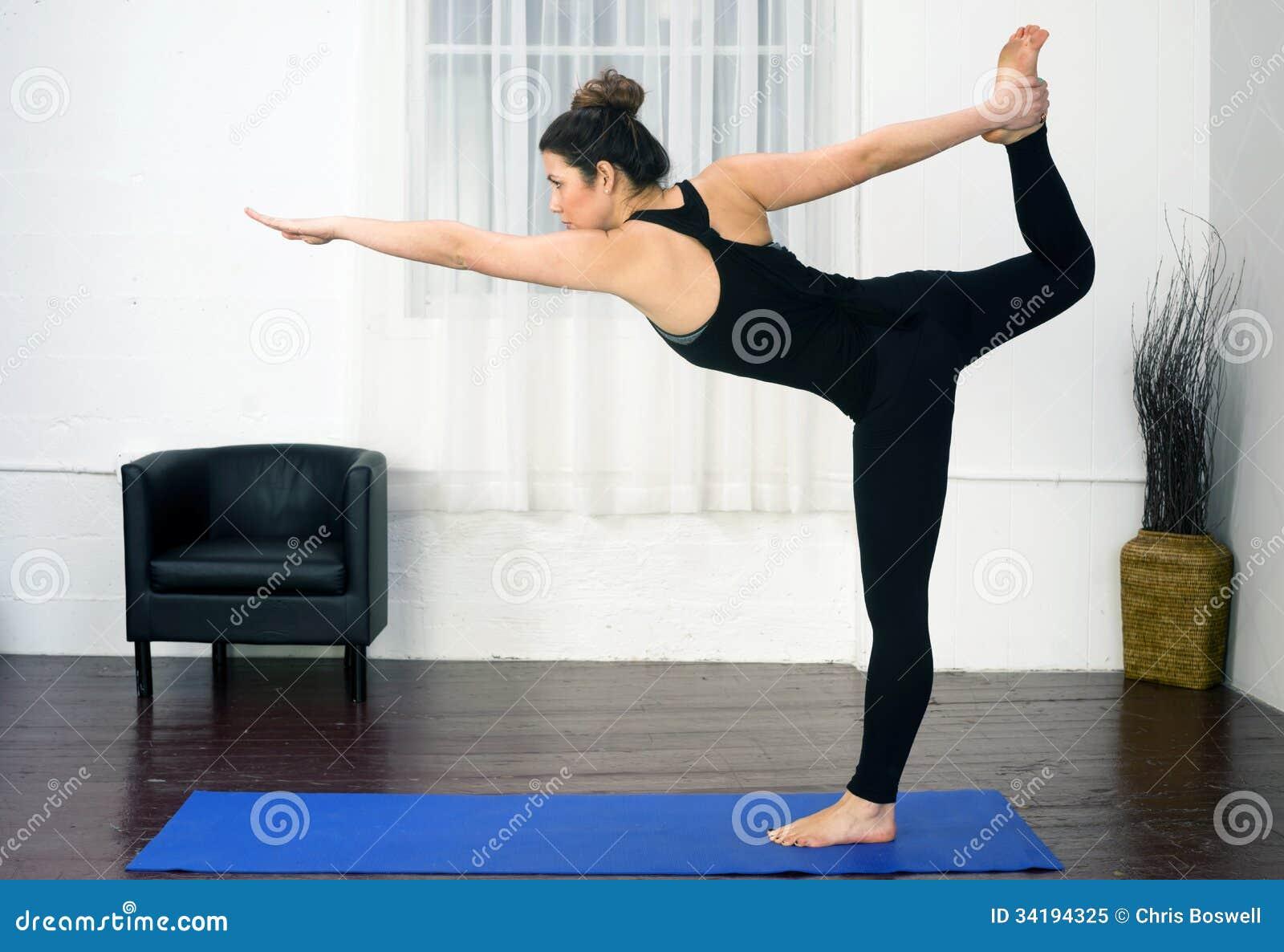 Young Attractive Woman Balances Standing Pose Yoga