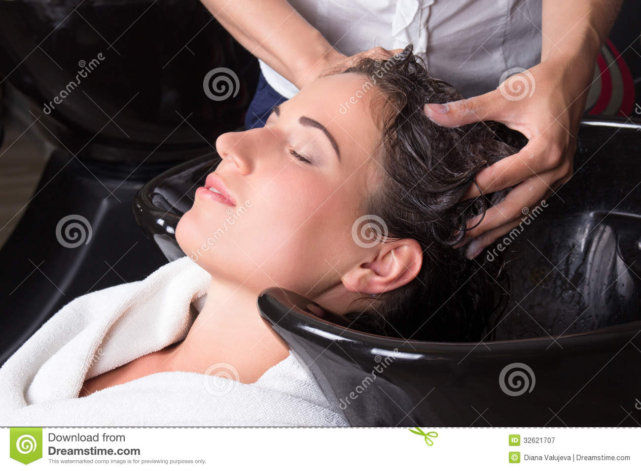 Young attractive woman getting a hair wash in salon for Wash hair salon