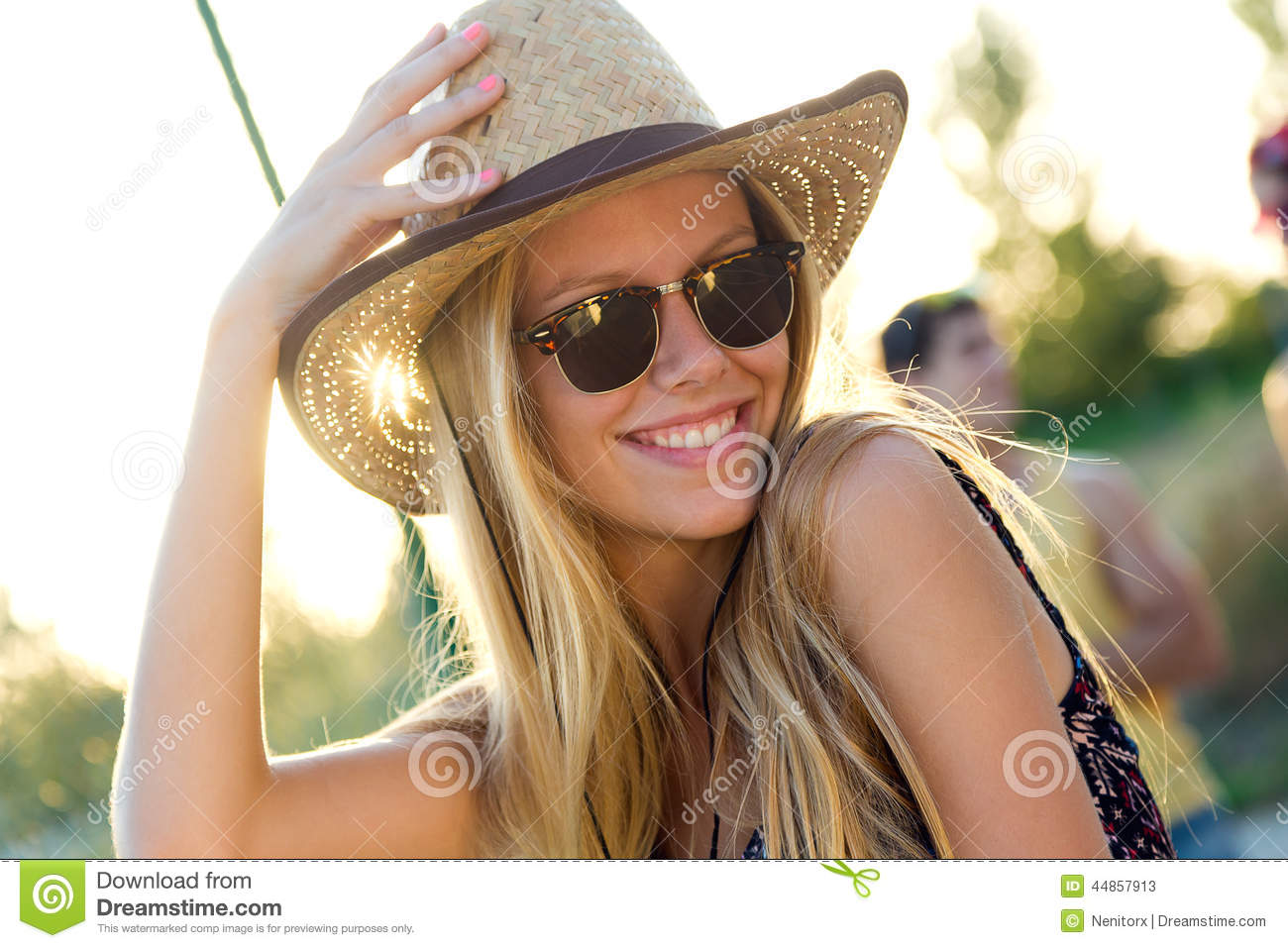 Young attractive woman with hat on a summer day.
