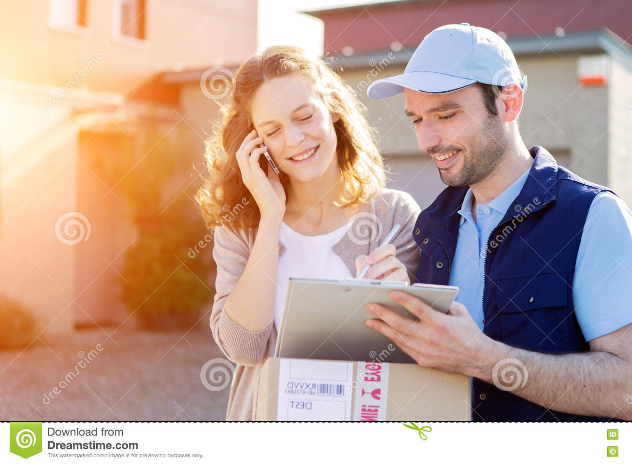 Young attractive woman receiving parcel at home