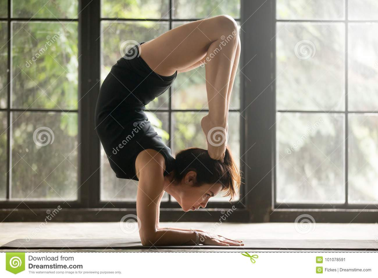 c07d76cdc7984 Young Attractive Woman In Scorpion Pose, Studio Background Stock ...