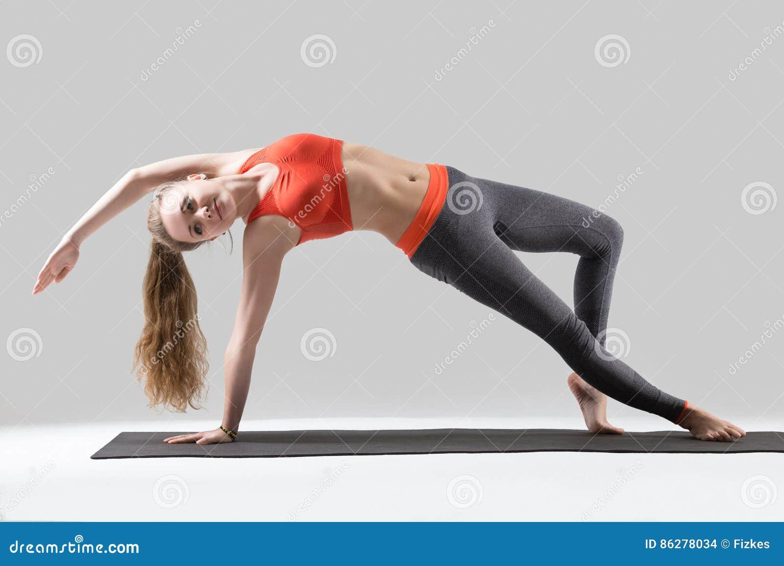 young attractive w stretching in camatkarasana pose grey st young attractive w stretching in camatkarasana pose grey st