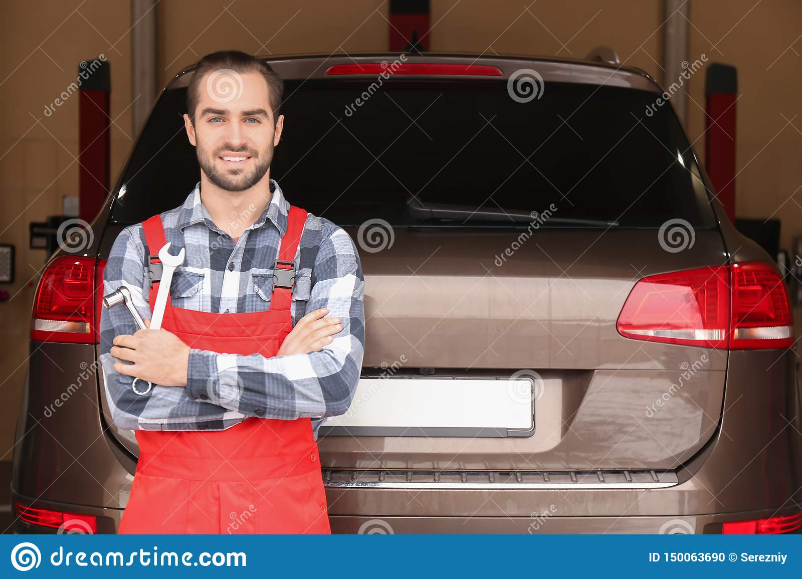Auto Repair Nearby >> Young Auto Mechanic With Tools Near Car In Service Center