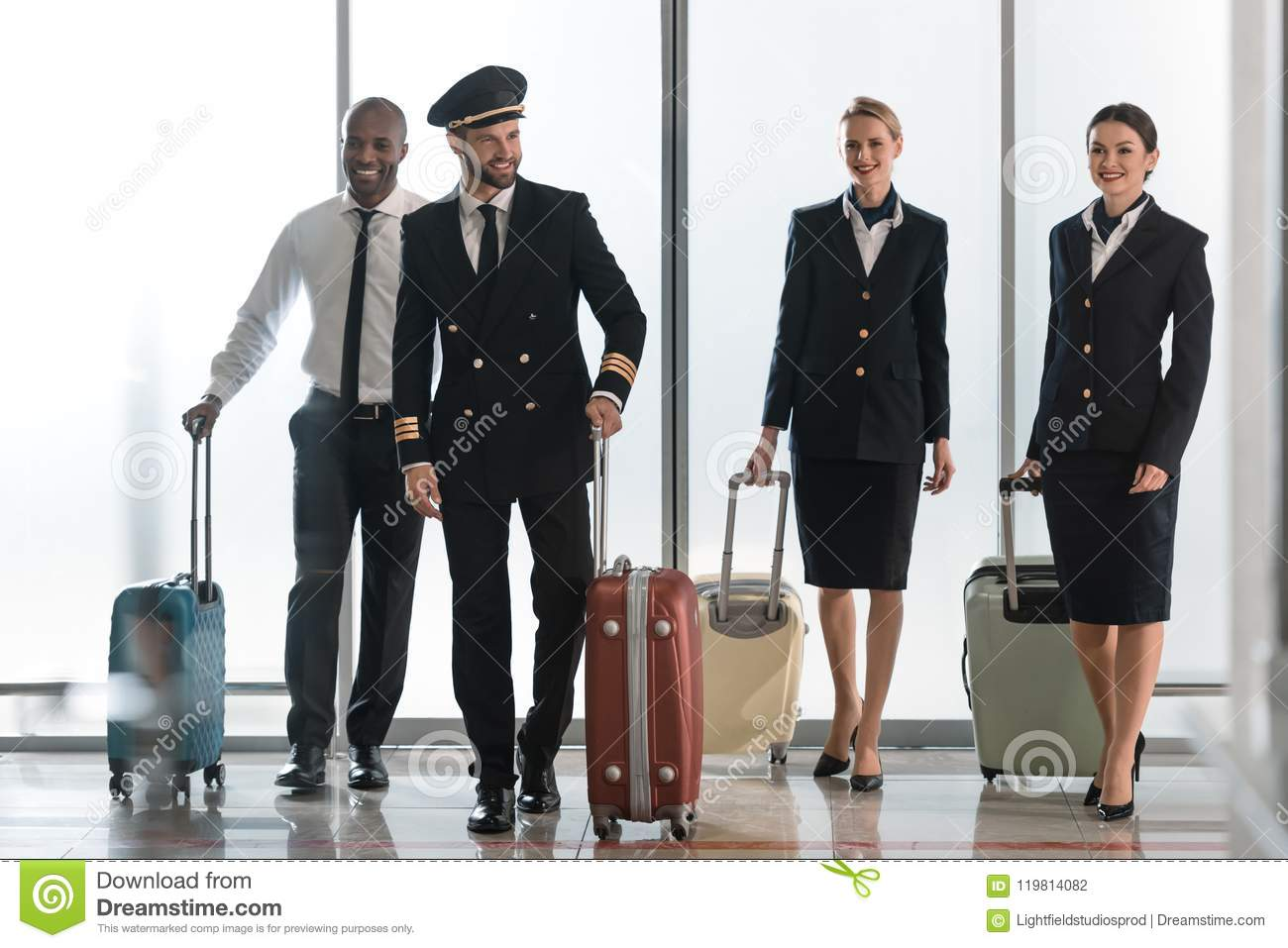 young aviation personnel team walking by airport loggy