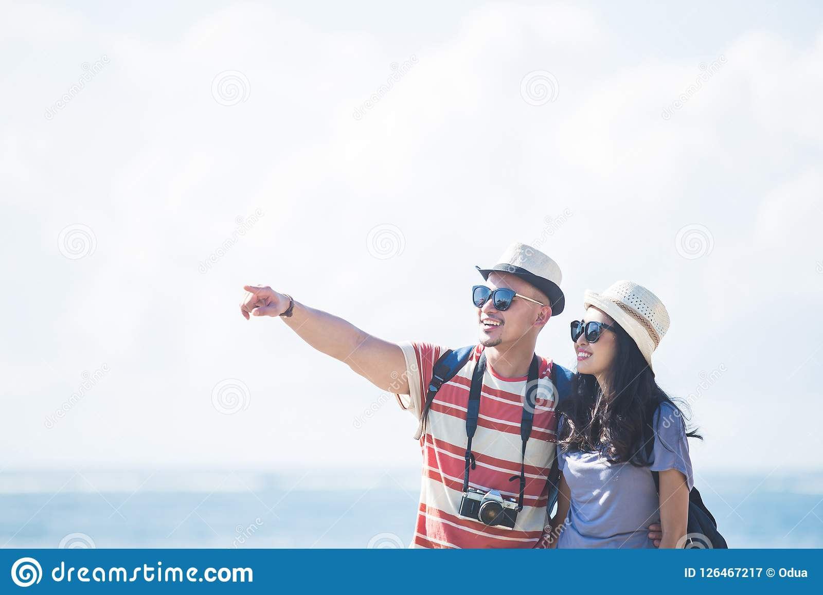 Young backpacker with his partner pointing at something during s