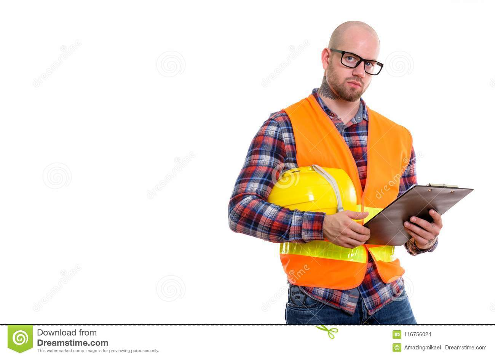 Young bald muscular man construction worker