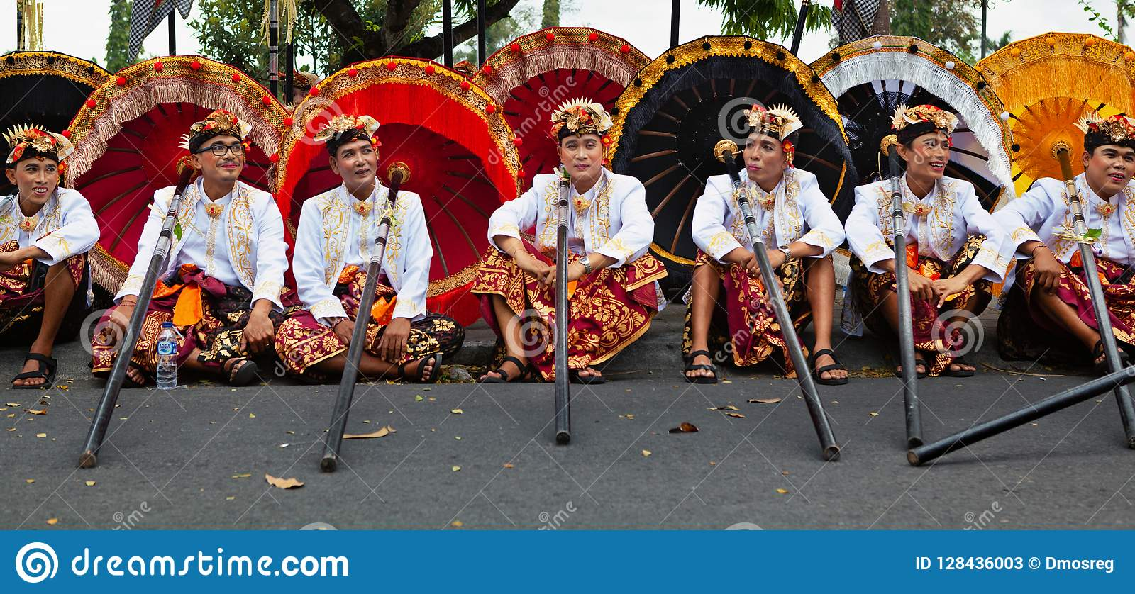 Young Balinese Men In Ethnic Costumes With Traditional