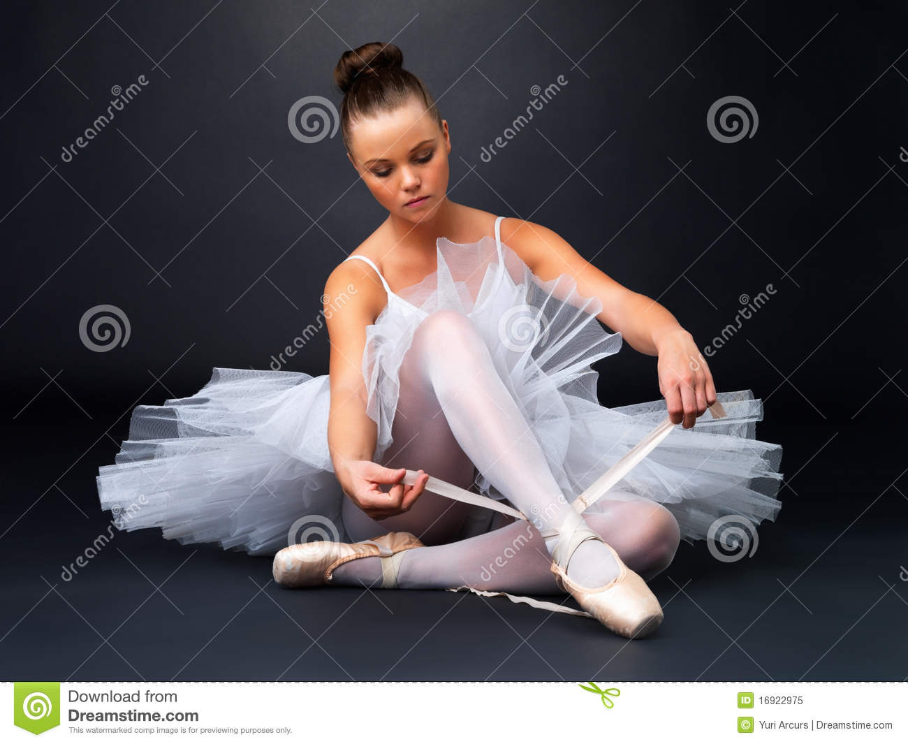 Royalty Free Stock Photo: Young ballerina puts on Pointe ...