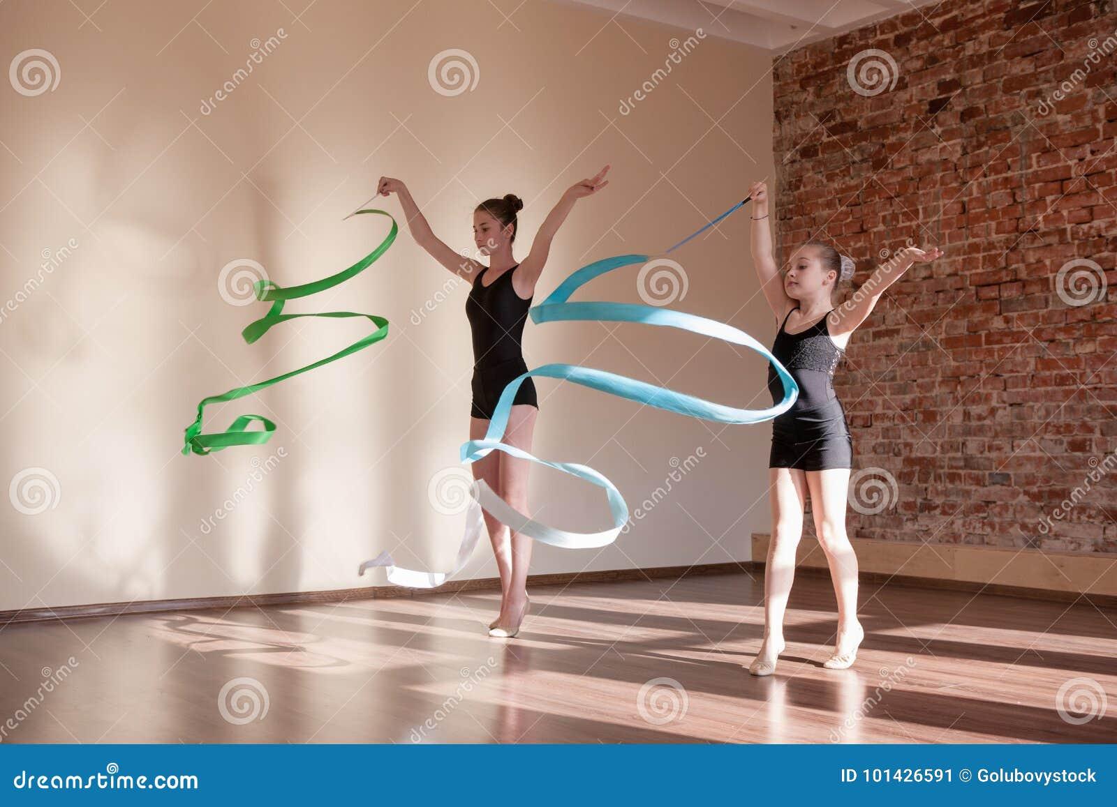 Girls gymnasts warm up. stock photo. Image of happy