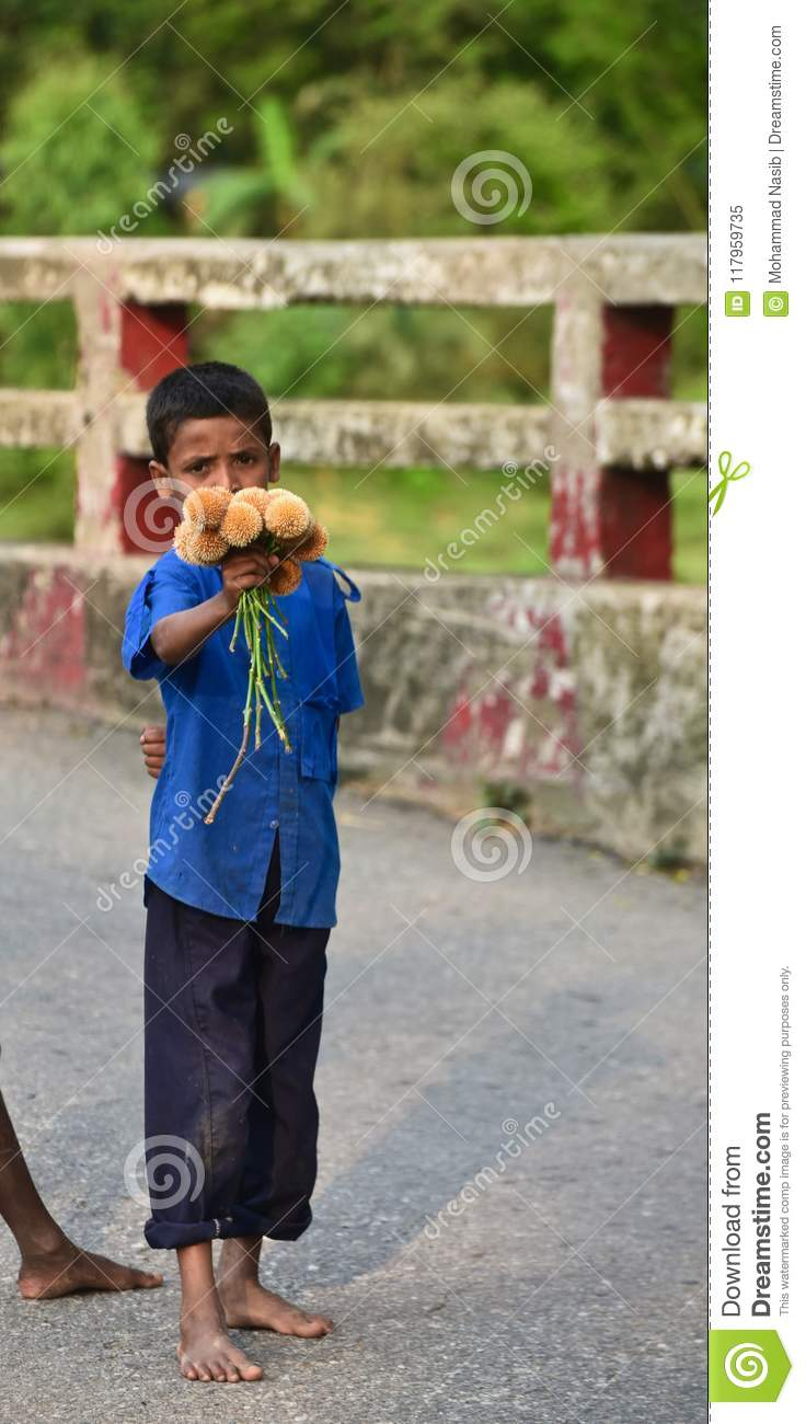 Download Young Kid Is Selling Flowers On The Street Isolated Unique Photograph Editorial Image - Image of children, background: 117959735