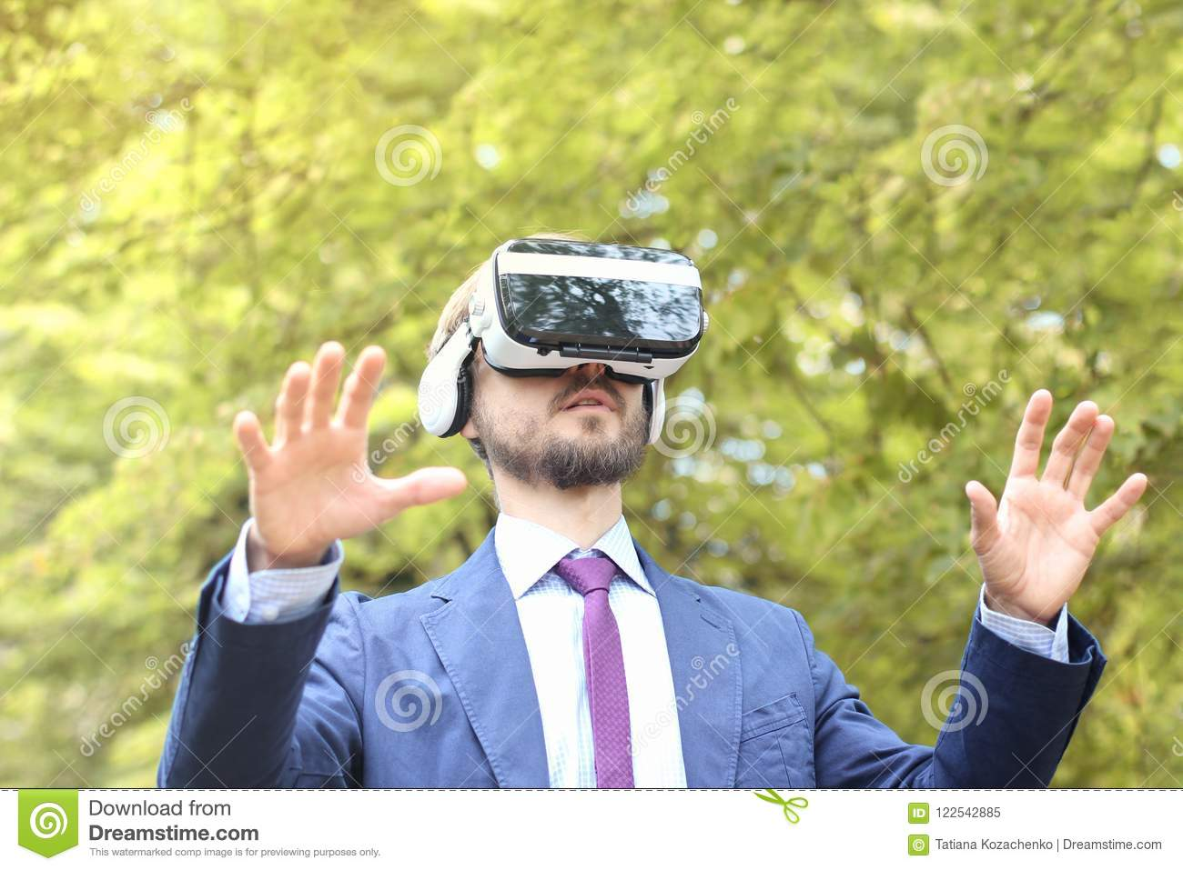 210683d611fc Young Bearded Businessman In Suit Uses Virtual Reality Glasses A ...