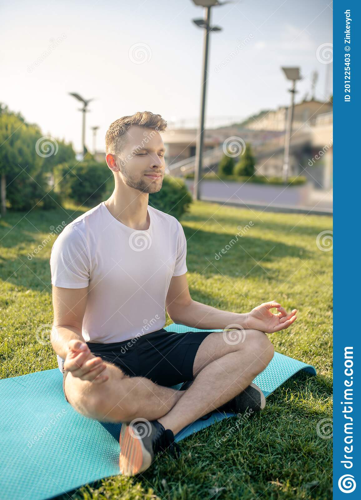 Young Bearded Male Sitting In Lotus Pose Outside, Eyes Closed ...