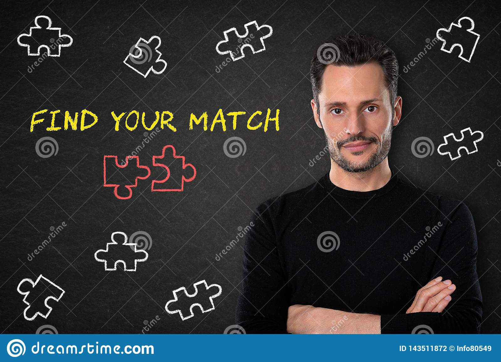 Young bearded man with crossed arms, puzzle pieces and text `Find your match` on a blackboard background.