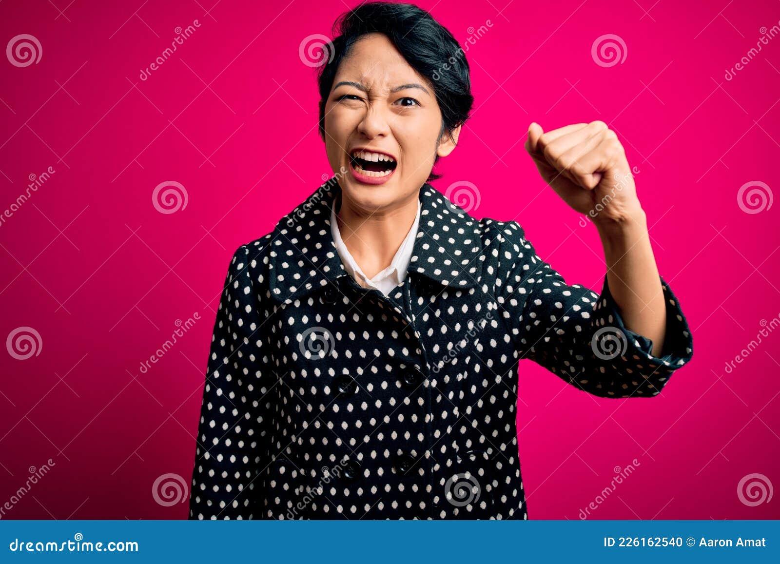 Young Beautiful Asian Girl Wearing Casual Jacket Standing