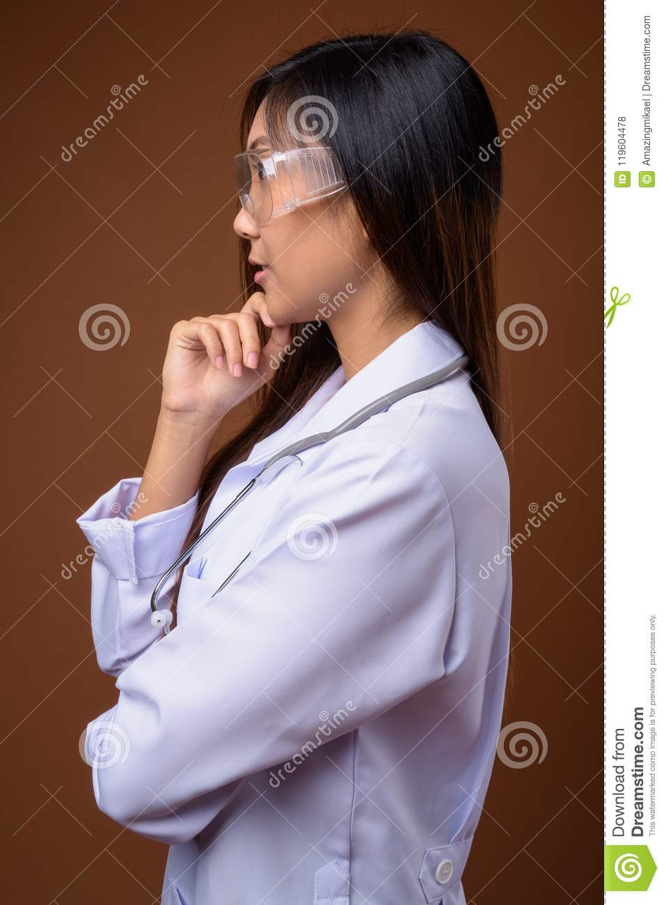 Young Beautiful Asian Woman Doctor Wearing Protective Glasses Ag