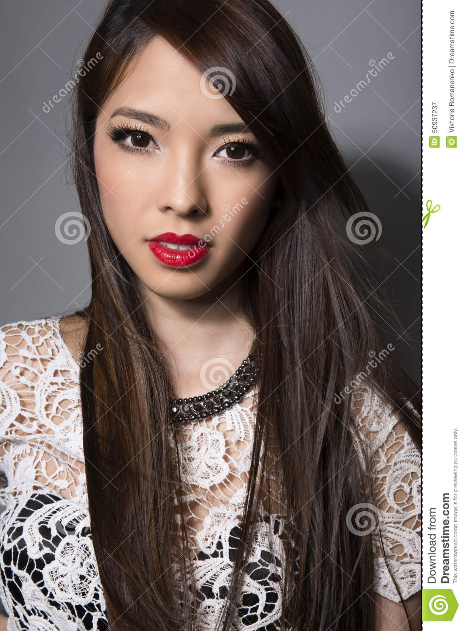 Young Beautiful Asian Woman With Flawless Skin And Perfect