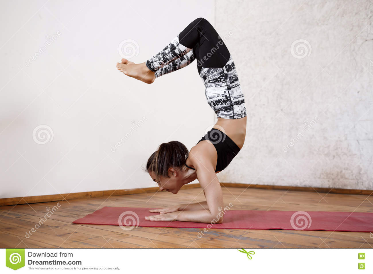 Download Young Beautiful Athletic Girl Practicing Indoor Yoga Asanas Advanced Inversion And Arm Balance