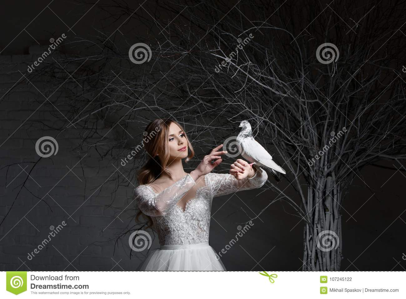 A young blonde bride in white wedding dress