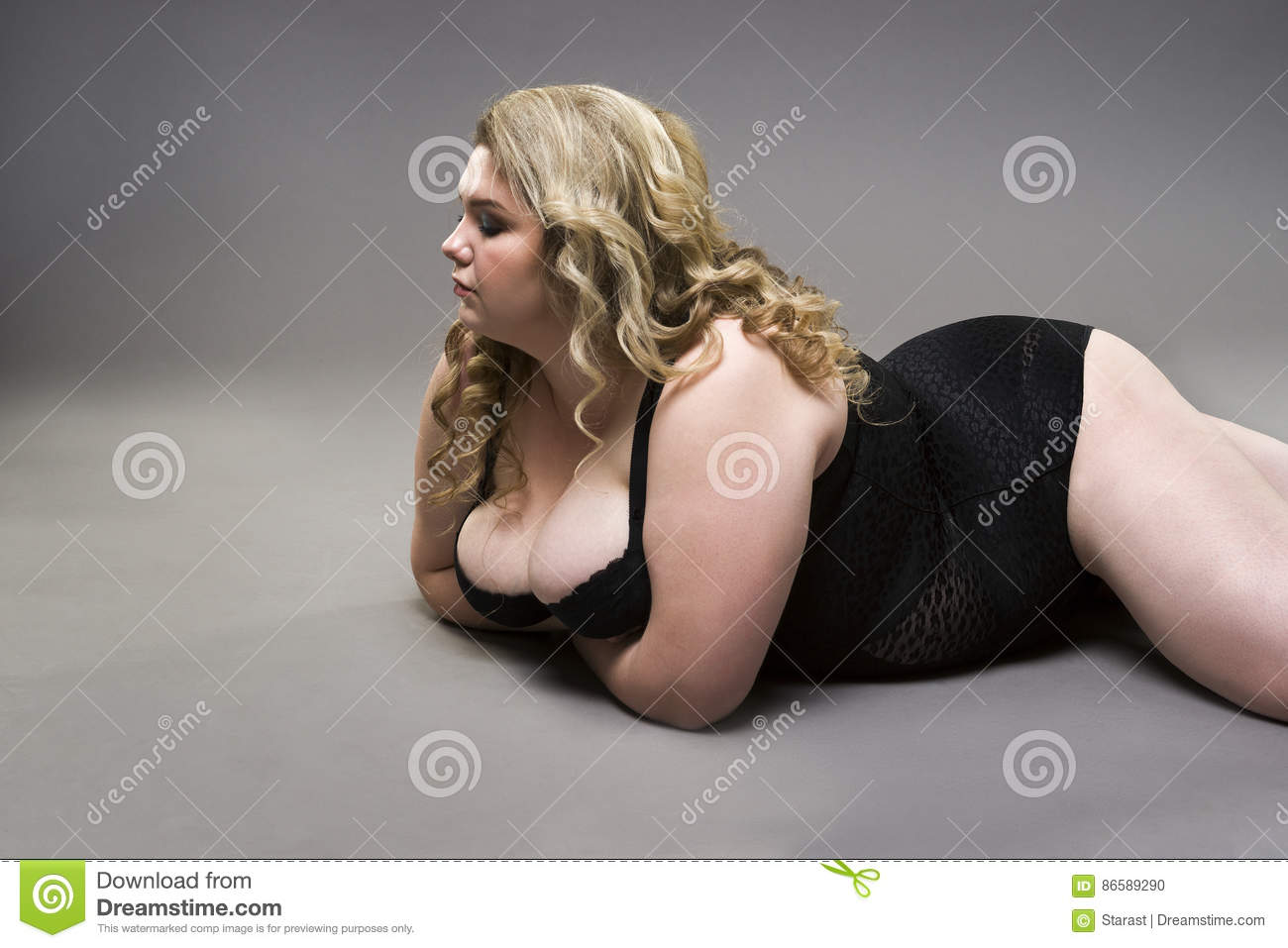 young beautiful blonde plus size model with big natural breasts in
