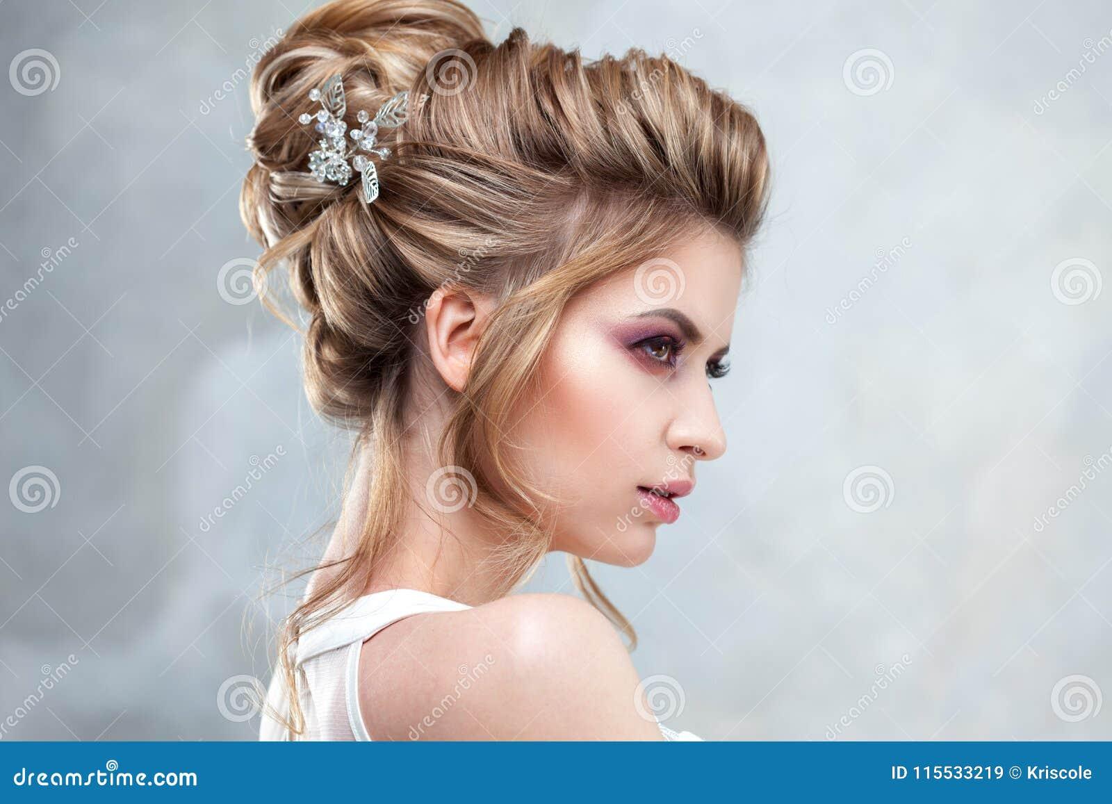 Young Beautiful Bride With An Elegant High Hairdo. Wedding