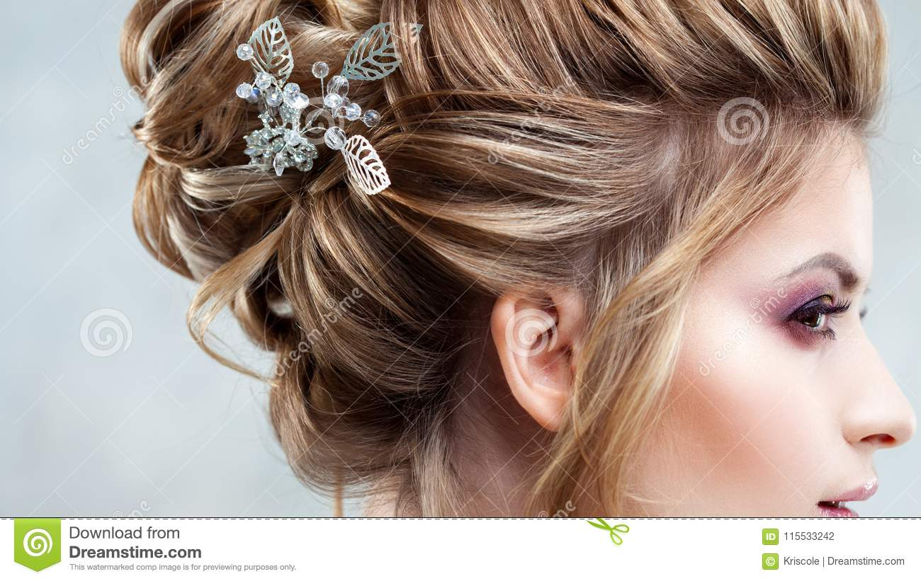 Young Beautiful Bride With An Elegant High Hairdo Wedding Hairstyle