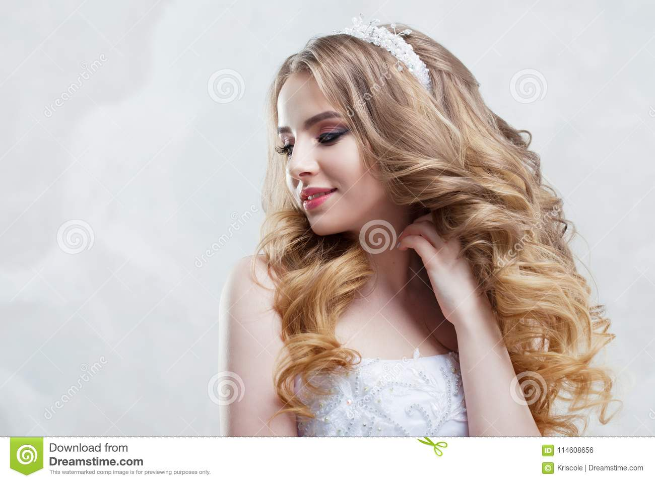 Young Beautiful Bride With Luxurious Curls Wedding Hairstyle With