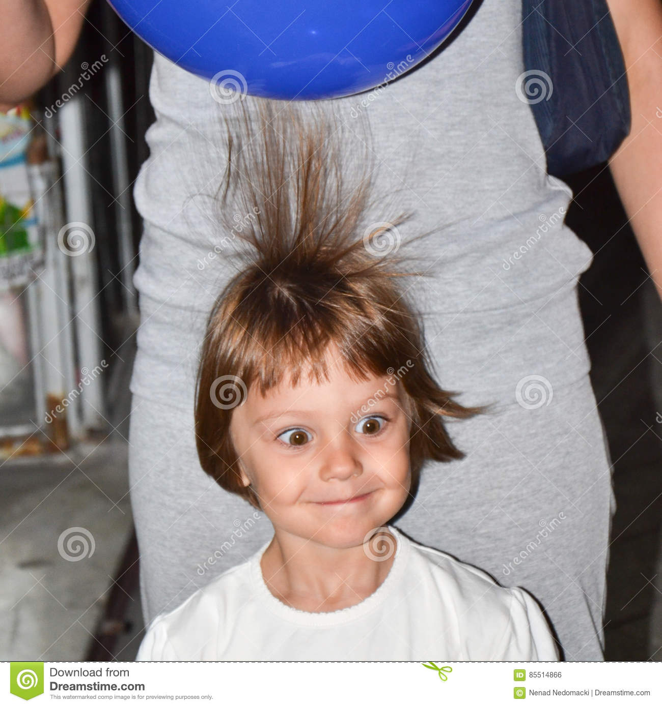 Young beautiful brown haired girl with electric loaded balloons