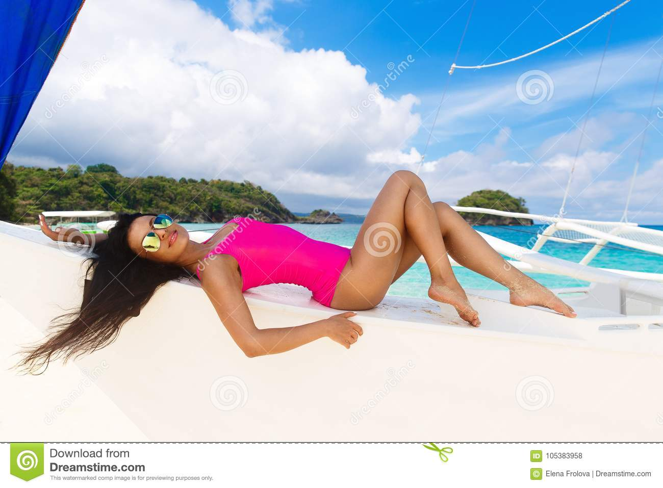 Young beautiful brunette having fun on a tropical beach on the s
