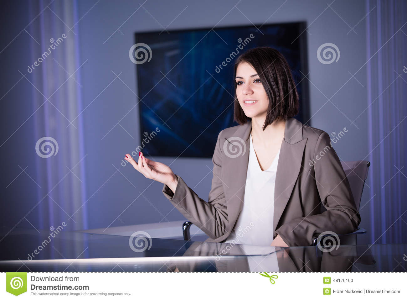 Young beautiful brunette television announcer at studio during live broadcasting.Female TV director at editor in studio.