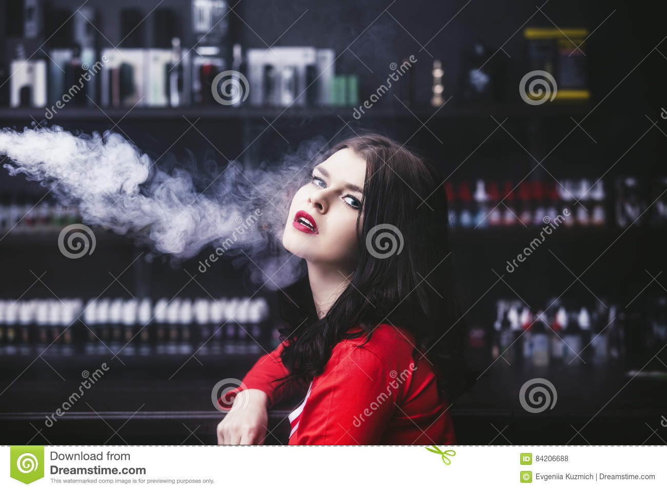Young beautiful brunette woman with fashion makeup at the bar wi