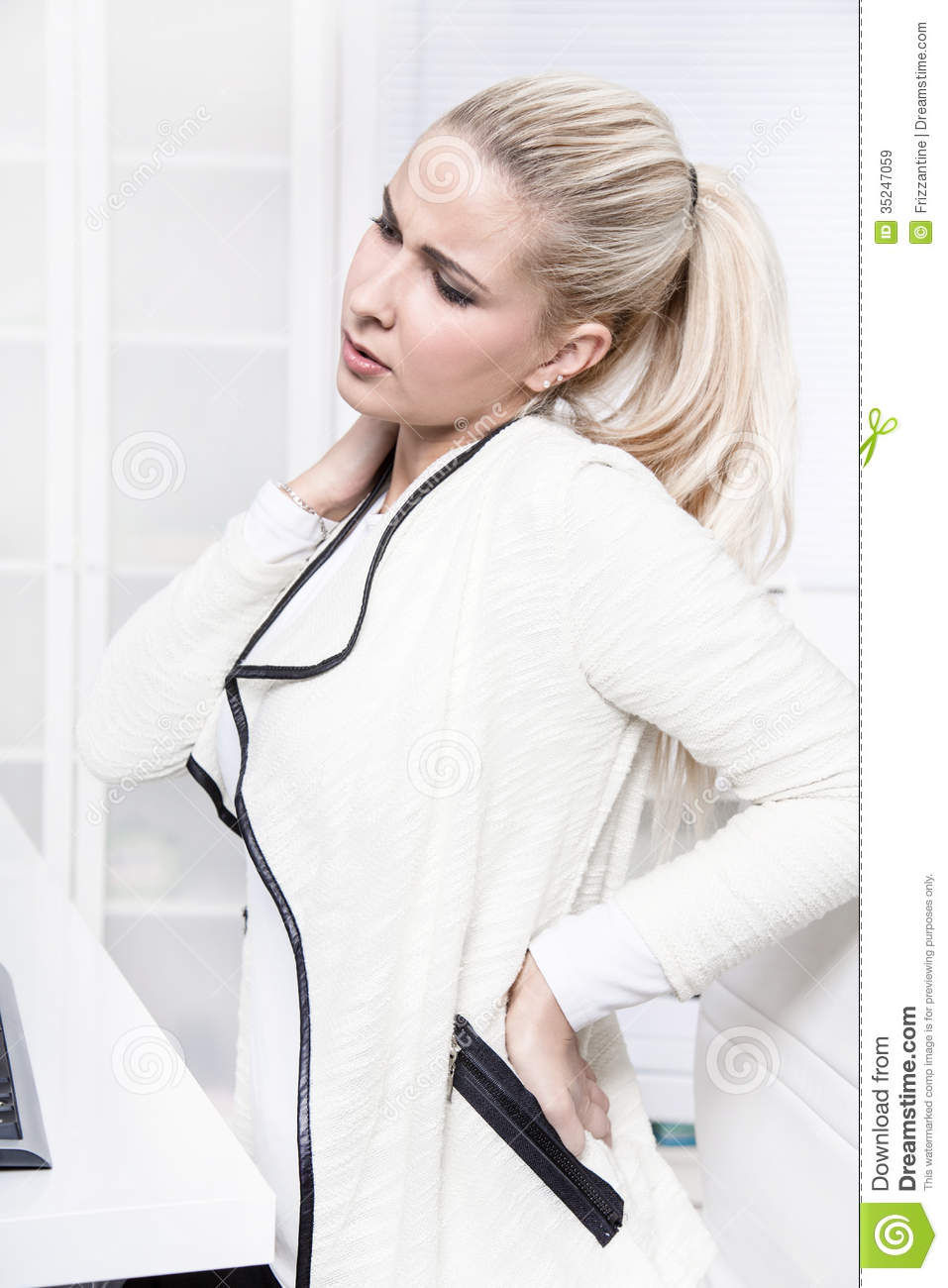 Young beautiful business woman has pains on her back