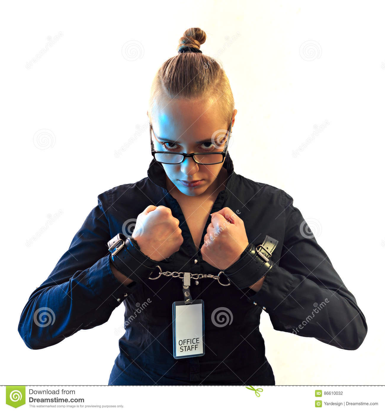 Young beautiful businesswoman screaming, prisoner of job in cuffs