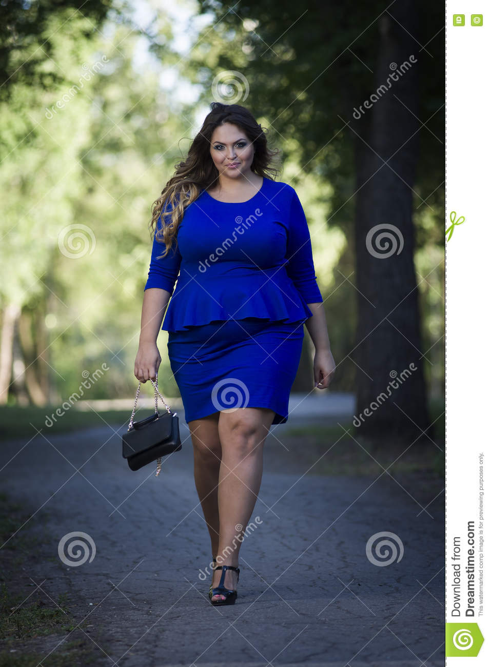 Young Beautiful Plus Size Model In Blue Dress Outdoors ...