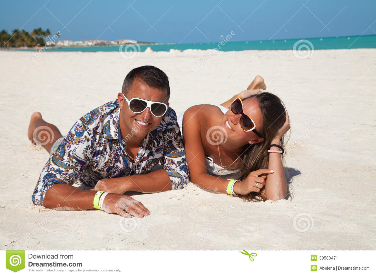 Young beautiful couple enjoying the sunset in luxury resort